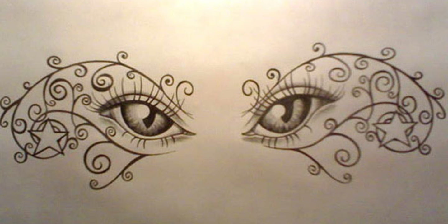 Tattoos Of Eyes On Lower Back