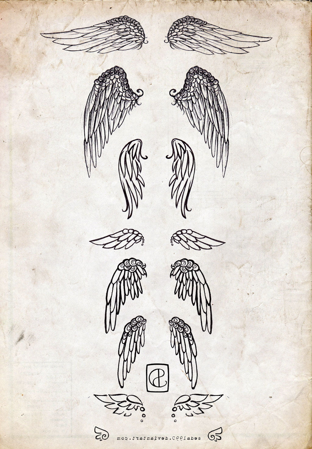 Pictures Of Small Angel Wing Tattoos