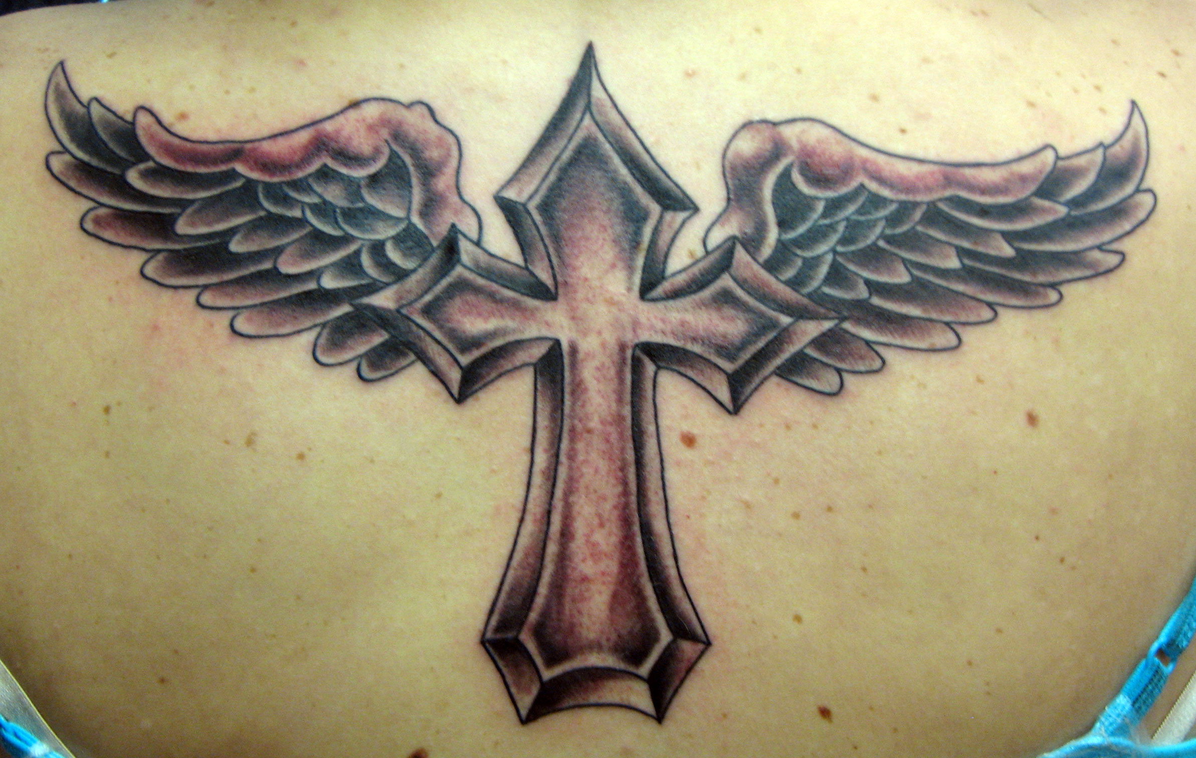 Cross tattoos wings cool tattoos bonbaden for Tattoo cross with wings