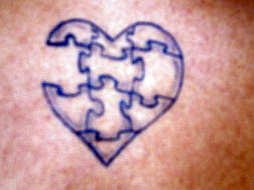 Heart Puzzle Piece Tattoo