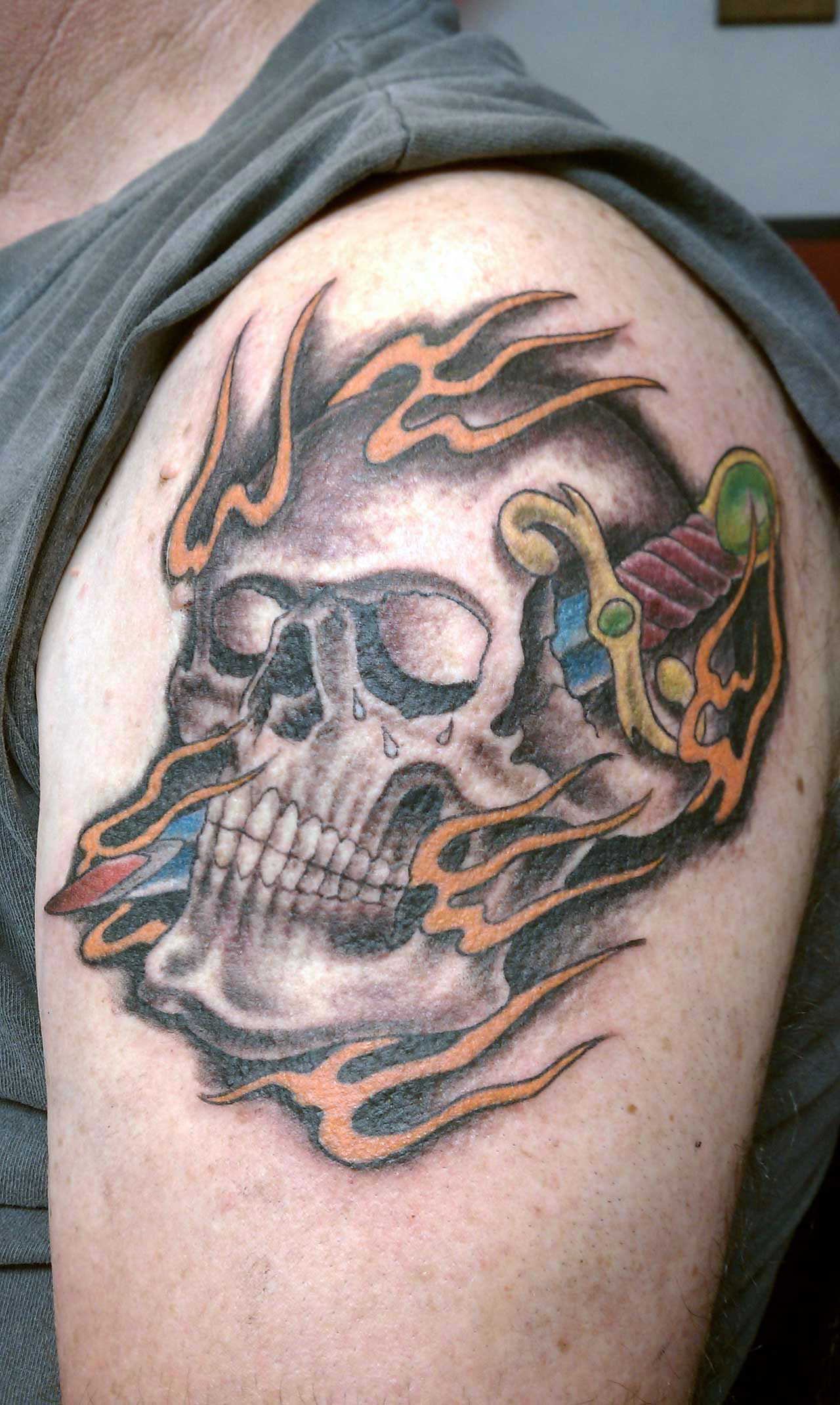 Skull And Dagger Tattoos